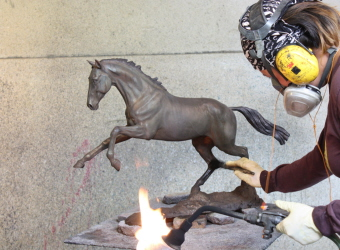 Applying the patina to the sculpture of Griffin