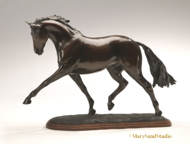 "Horse sculpture of dressage horse performing the extended trot.  Sculpture is bronze limited edition, titled ""Breathtaking"""