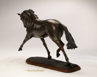 Horse sculpture of dressage horse performing the extended trot.  Sculpture titled Breathtaking, bronze limited edition.
