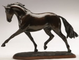 Horse sculpture of dressage horse performing extended trot